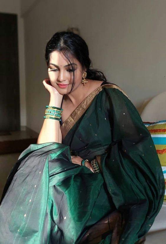 woman wearing green in shrawan